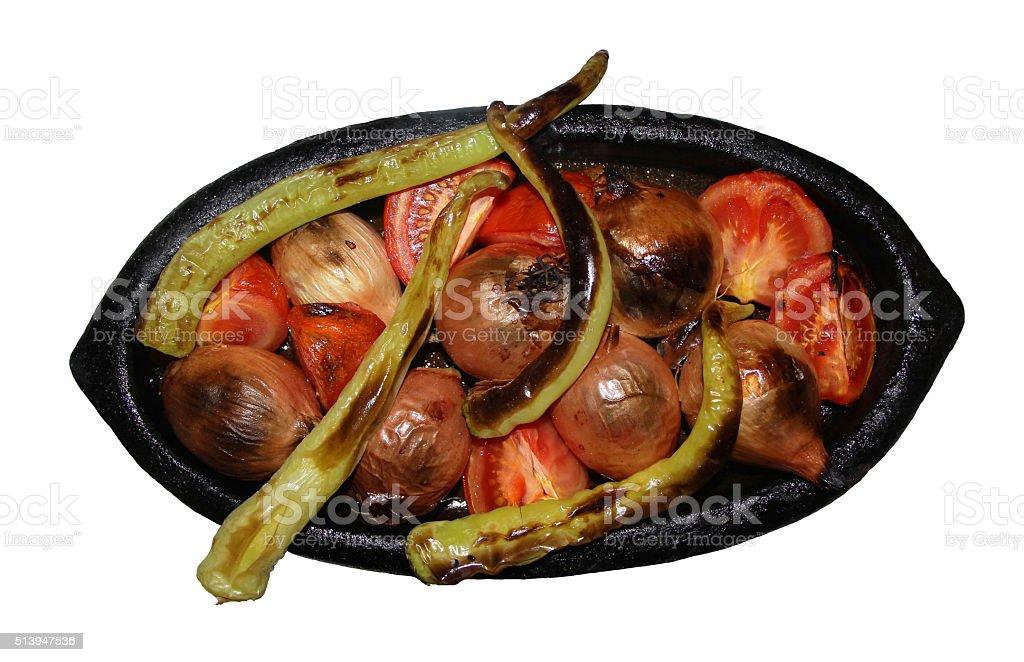 Onion pepper and tomato in earthenware pot stock photo
