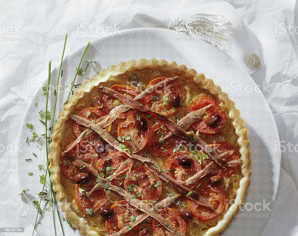 Onion pie with anchovy and tomatoes. stock photo