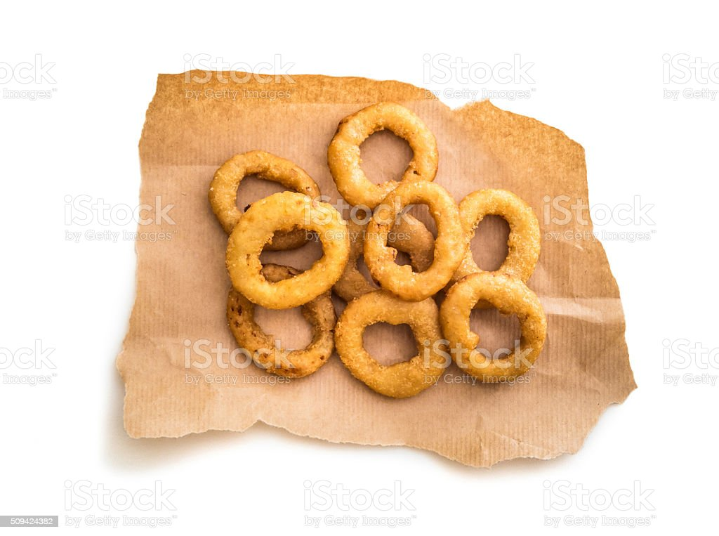 onion rings on parchment stock photo