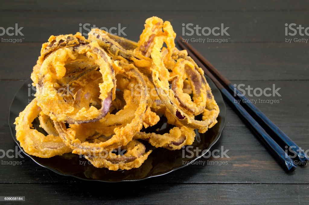 onion rings with chopsticks stock photo