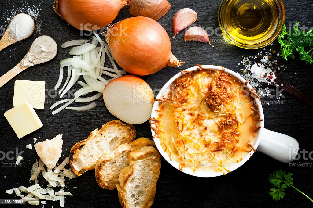 Onion soup and ingredients stock photo