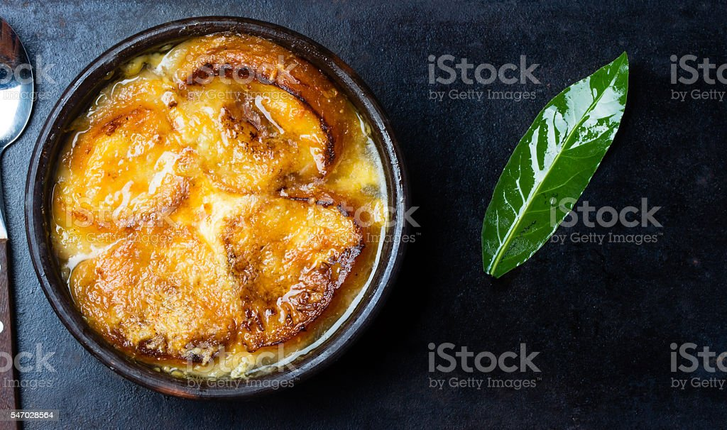 Onion soup with dried bread and cheese. Top view stock photo