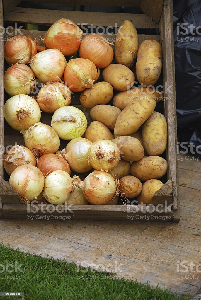 Onions and patatos in a Crate. royalty-free stock photo