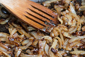 Onions caramelizing in frying pan