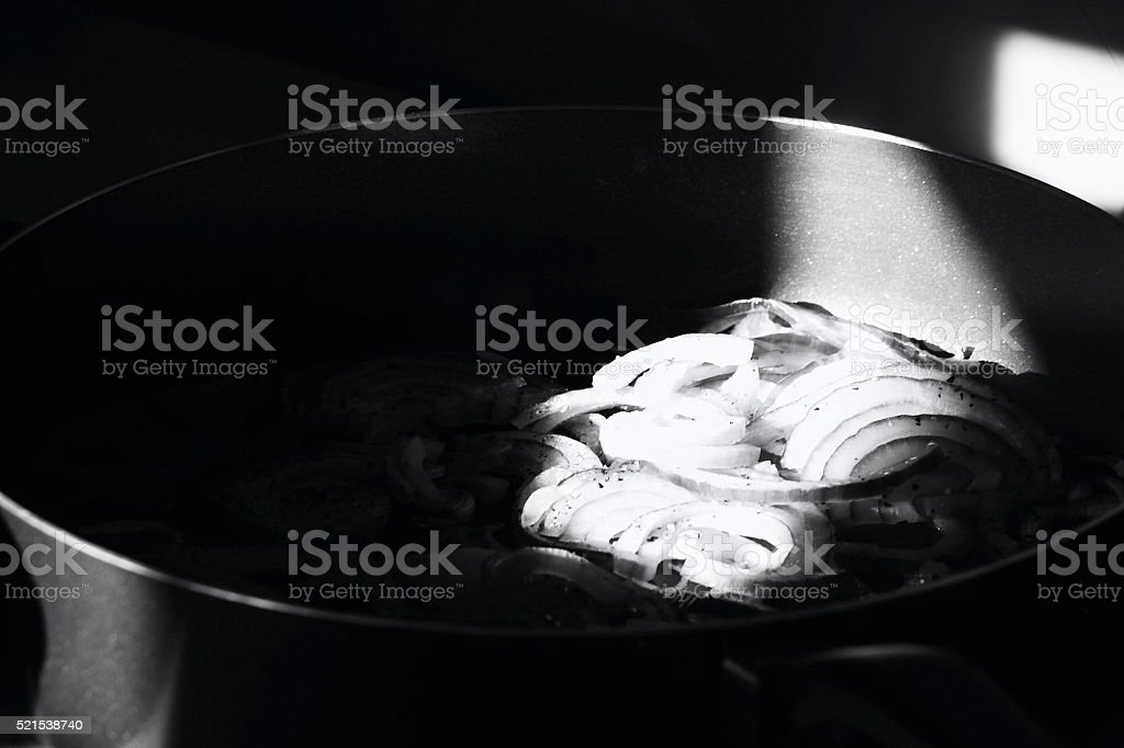 Onions cooking in a skillet stock photo