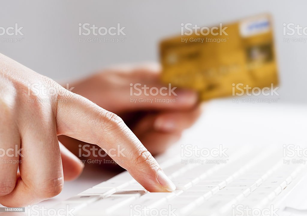 Online activity as woman's hands do some e-shopping stock photo