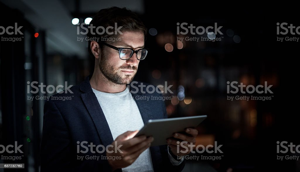 Online and up to date all night long stock photo