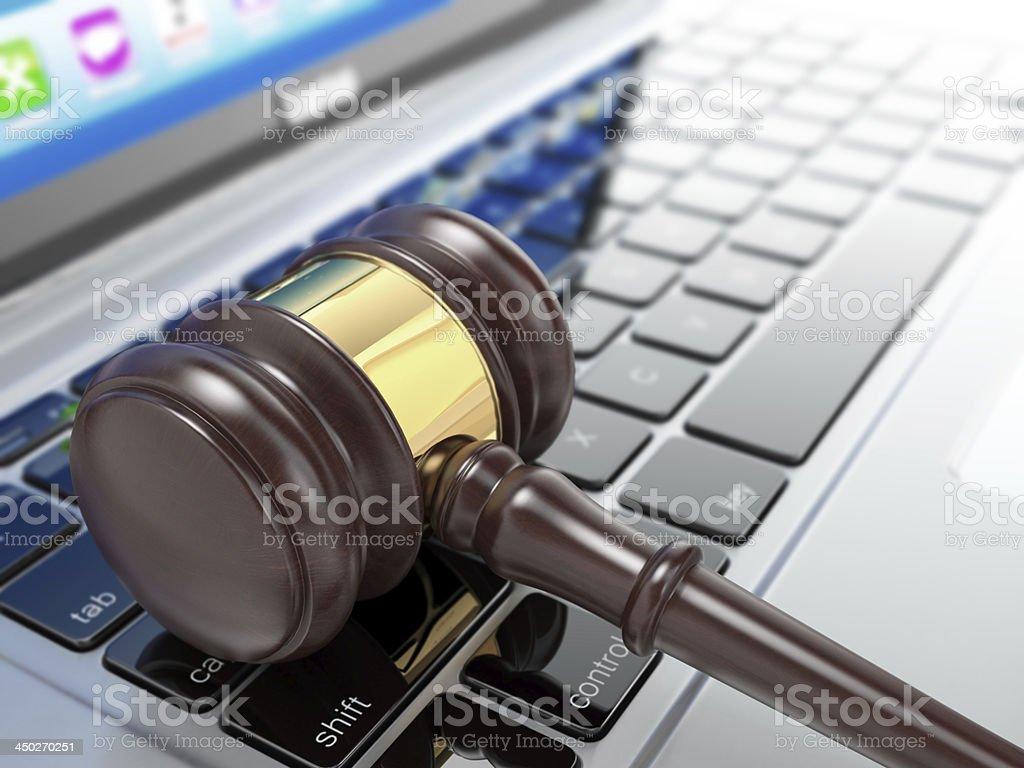 Online auction. Gavel on laptop. 3d stock photo