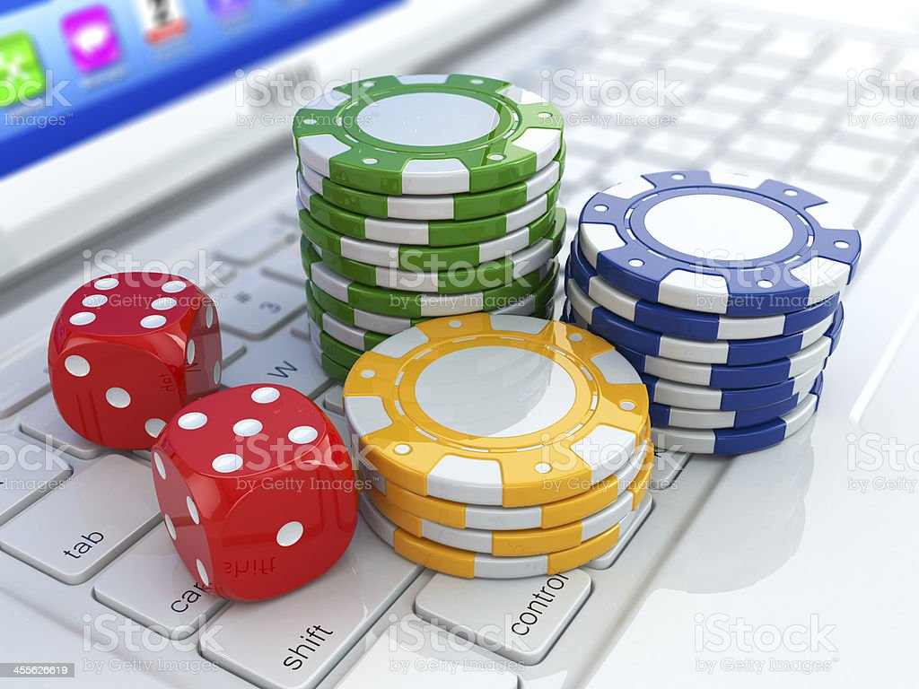 Online casino. Dices and chips on laptop. stock photo