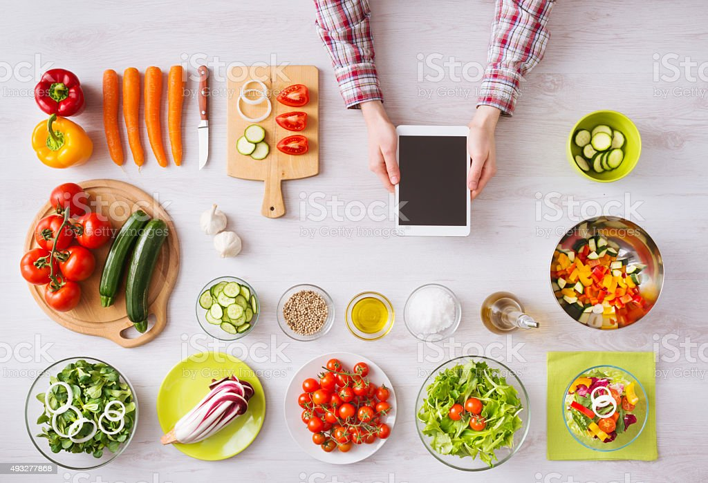 Online cooking app with kitchen worktop stock photo
