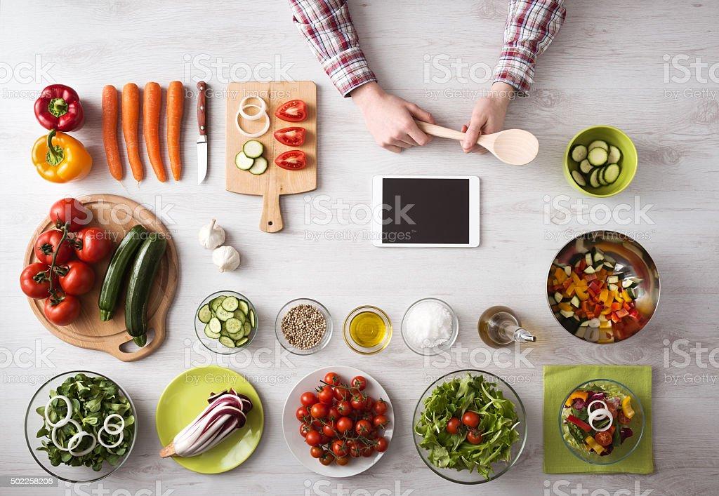 Online cooking app with kitchen worktop stock photo