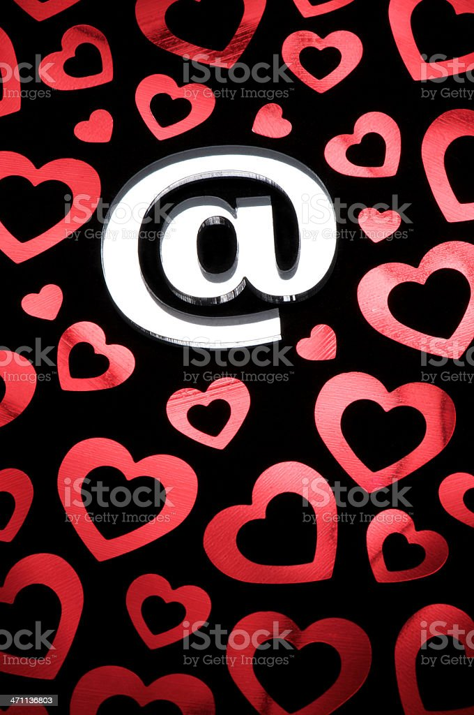Online Dating Shiny @ At Sign with Hearts royalty-free stock photo