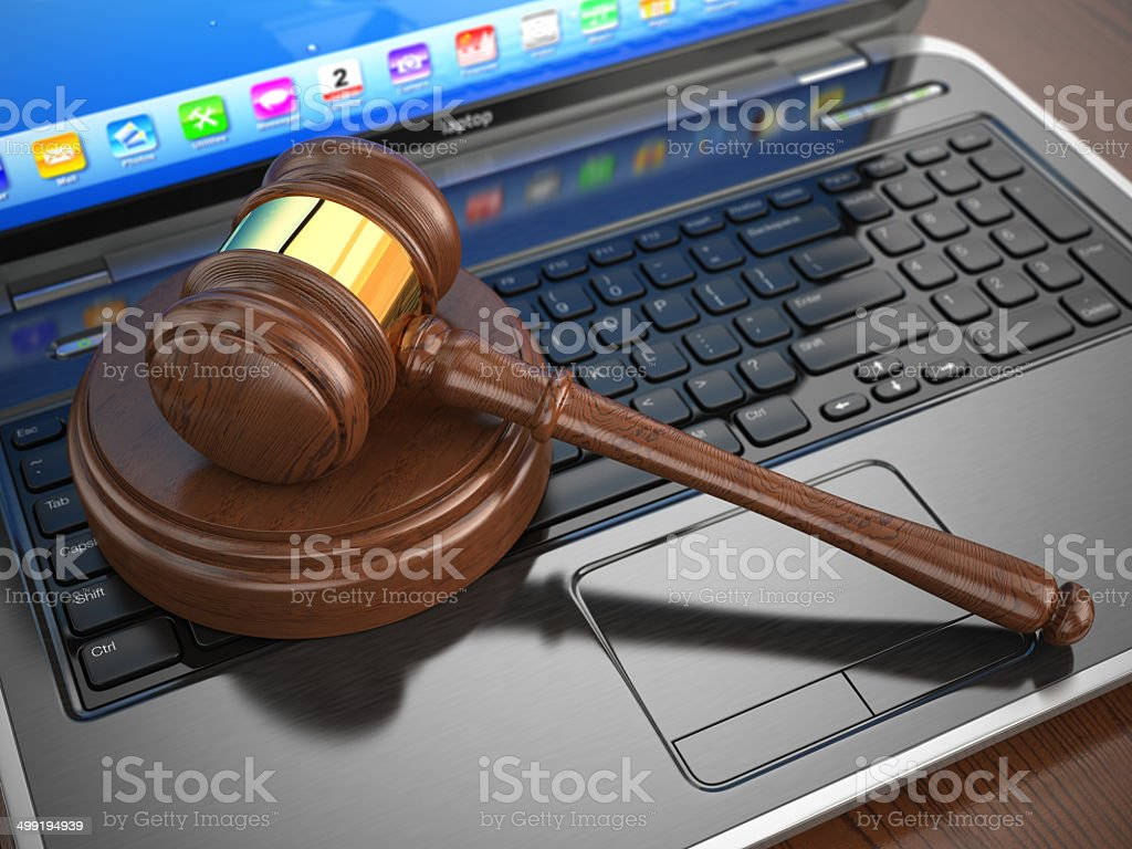 Online internet auction. Gavel on laptop. stock photo