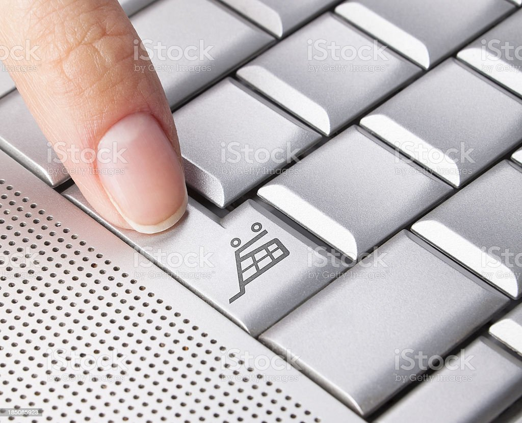 On-line Internet Shopping. Finger pressing the key. Blank Keyboard. royalty-free stock photo