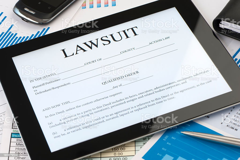 Online lawsuit form on a digital tablet stock photo