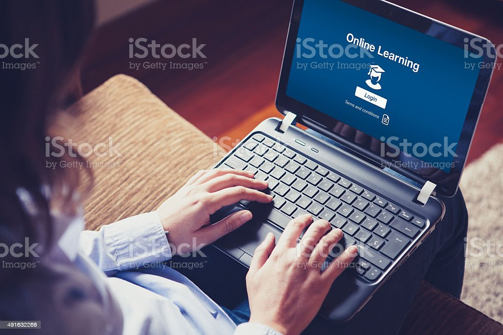'Online Learning' on the screen. stock photo
