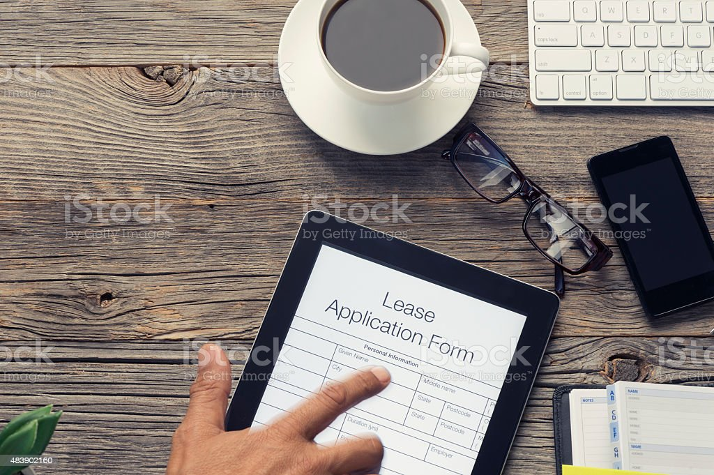 Online lease application form with pointing finger. stock photo