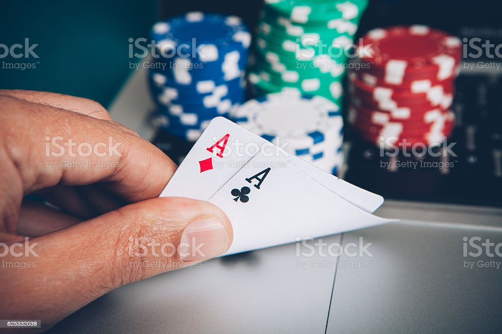 Online play poker hand with two aces stock photo