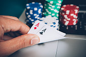 Online play poker hand with two aces