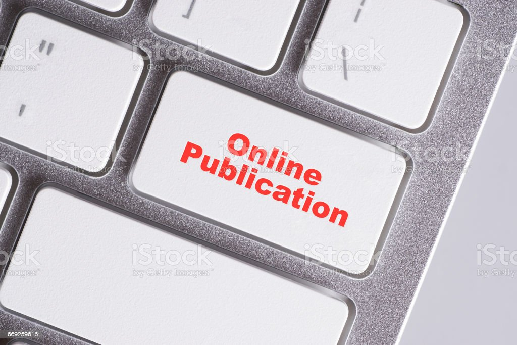 'Online Publication' red words on white keyboard - online, education and business concept stock photo