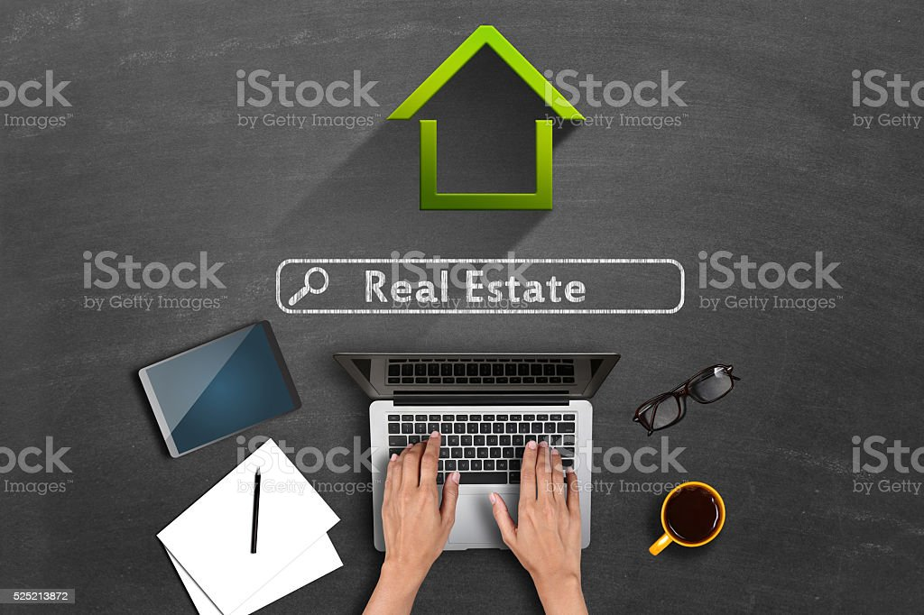 Online real estate concept on blackboard stock photo