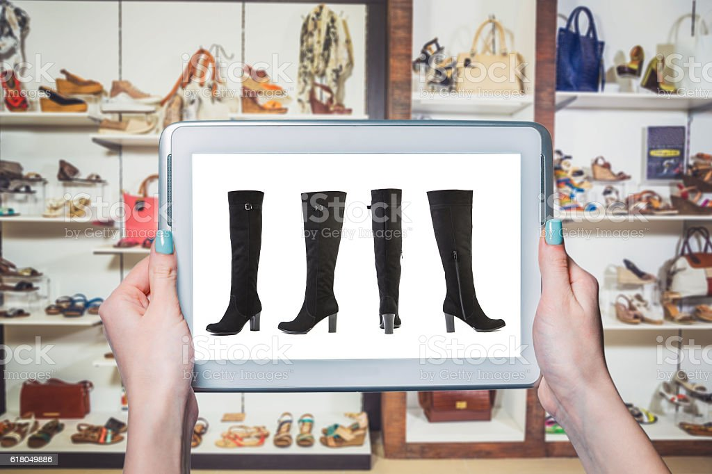 On-line sales of footwear online store stock photo