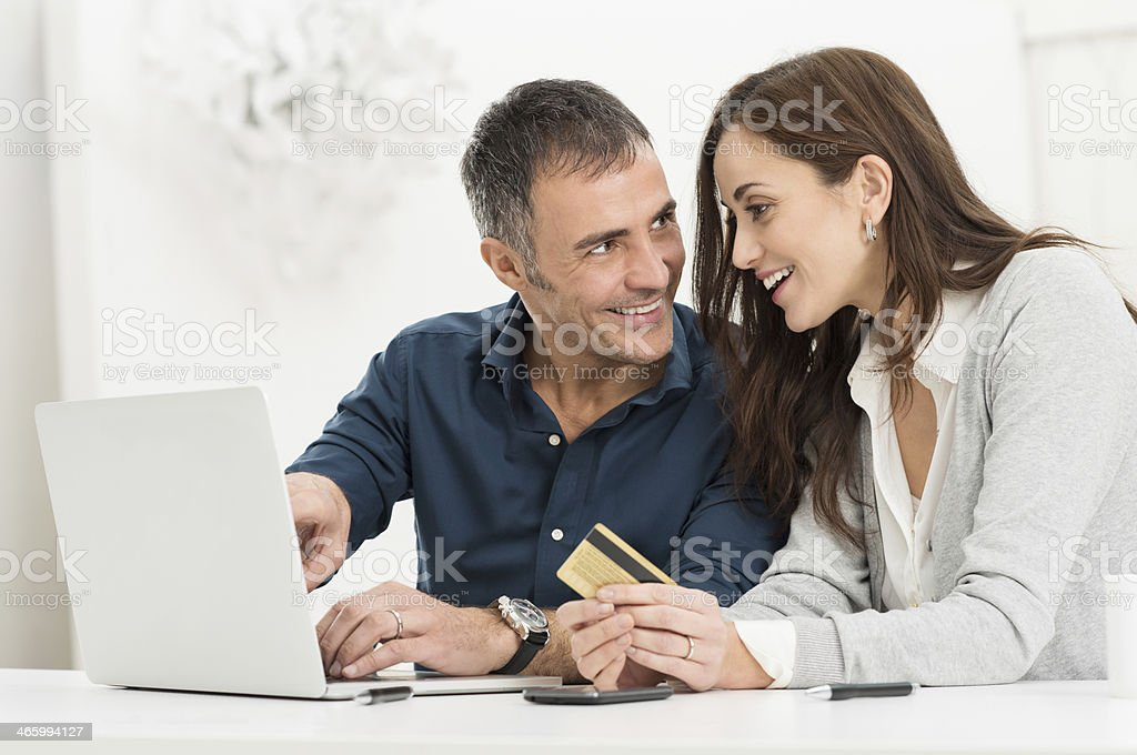 Online shopping together on a laptop stock photo