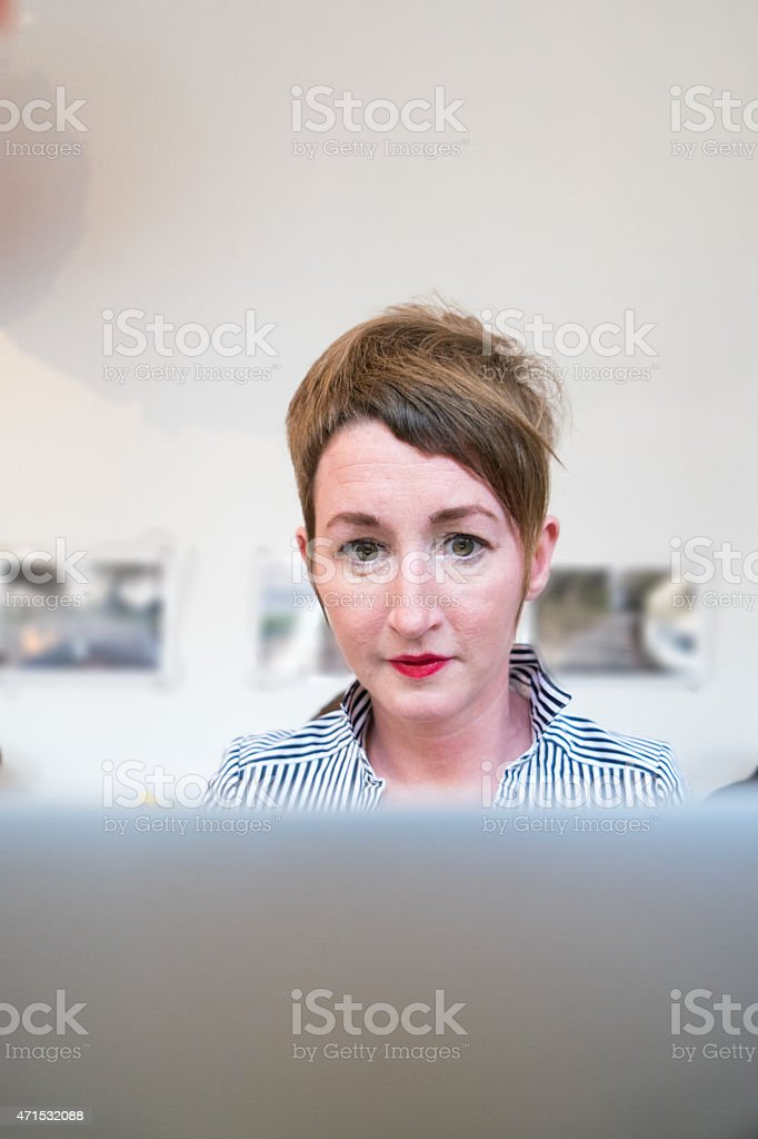 Online Shopping, Woman Using Laptop To Purchase stock photo