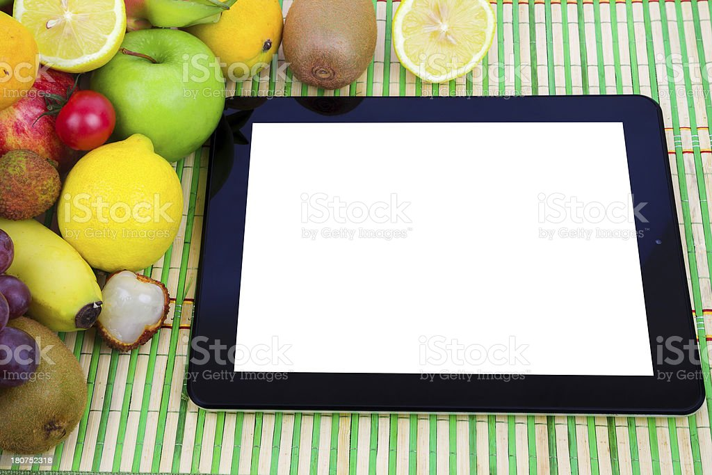Online shopping:fruit variety and digital tablet royalty-free stock photo