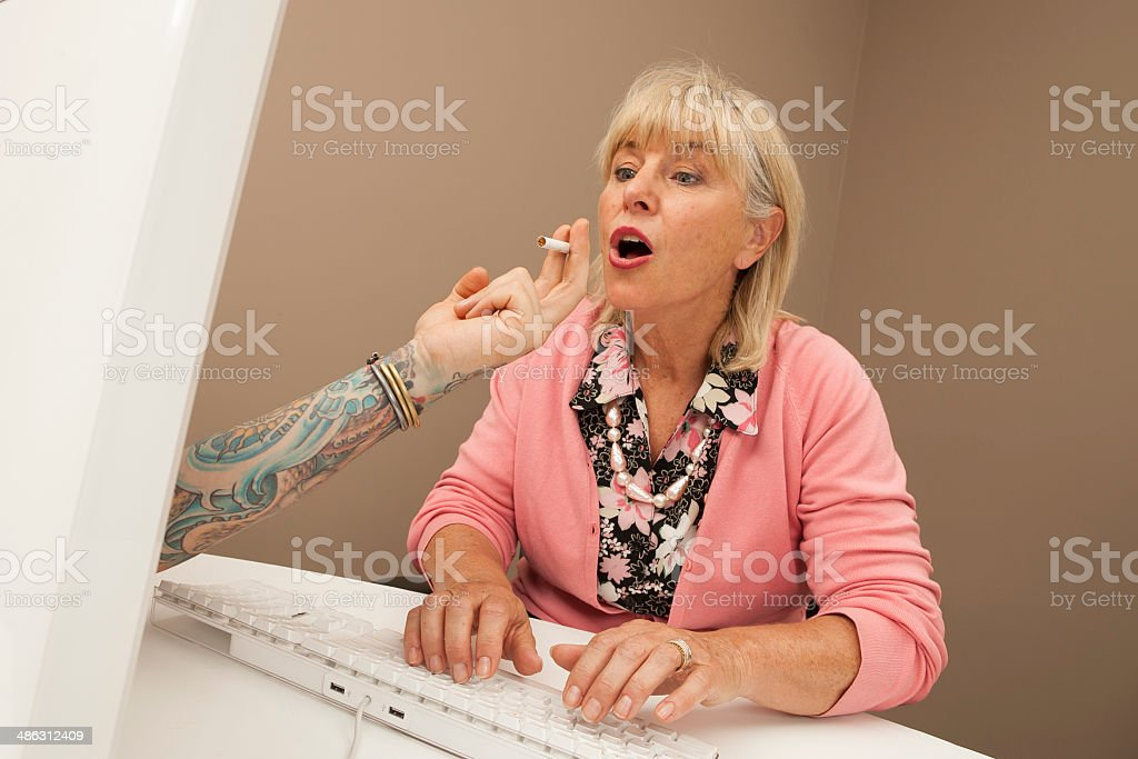 Online Smoking Temptation for Blonde Caucasian Woman stock photo
