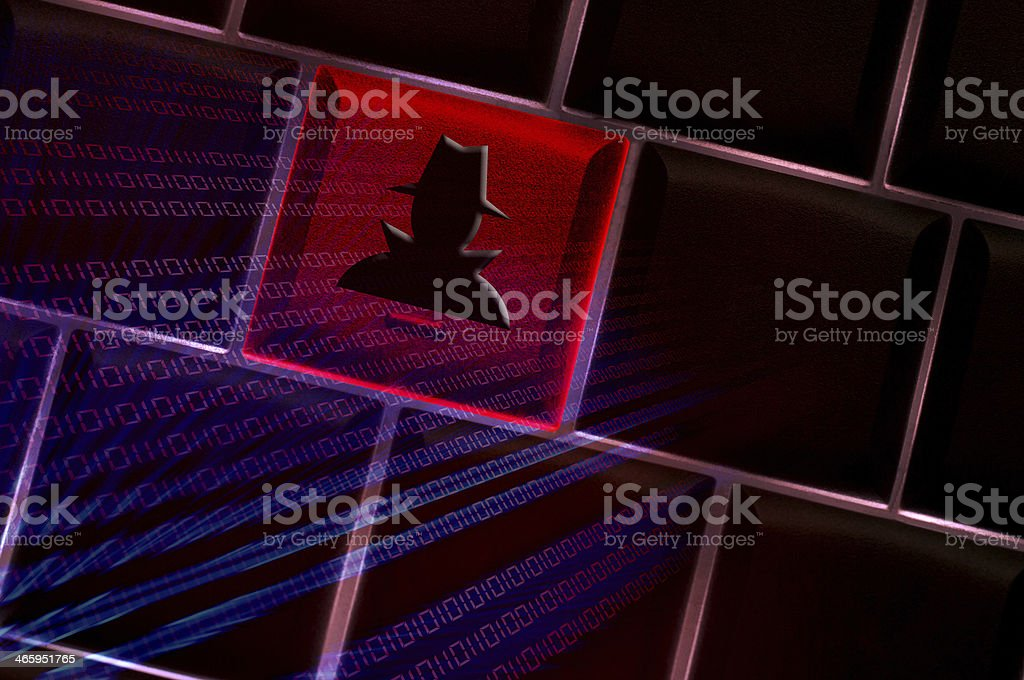 Online spyware concept with backlit laptop keyboard stock photo