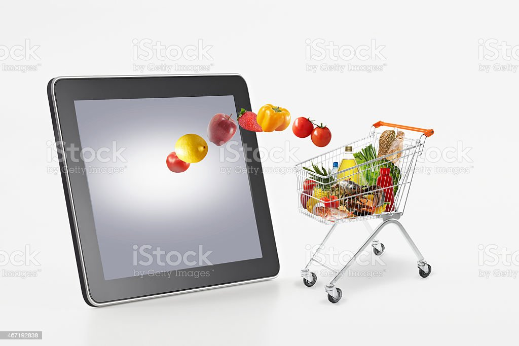 Online supermarket Shopping from tablet stock photo