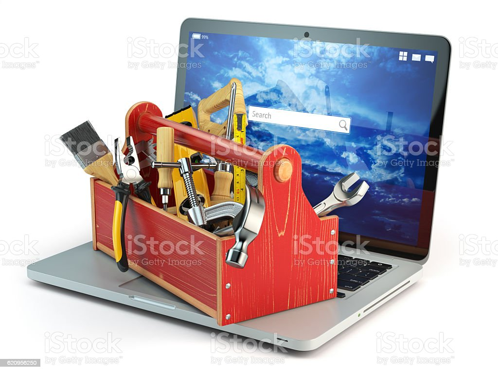 Online support. Laptop and toolbox with tool  isolated on white stock photo