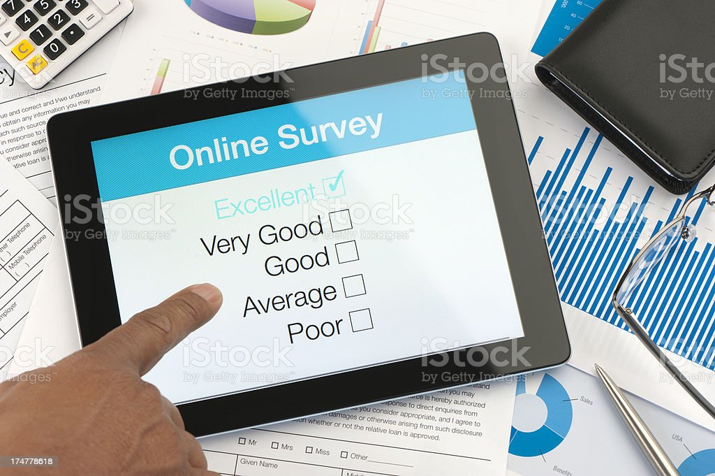 Online survey on a digital tablet royalty-free stock photo