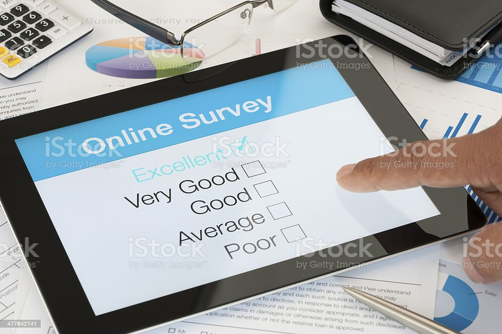 Online survey on a digital tablet stock photo