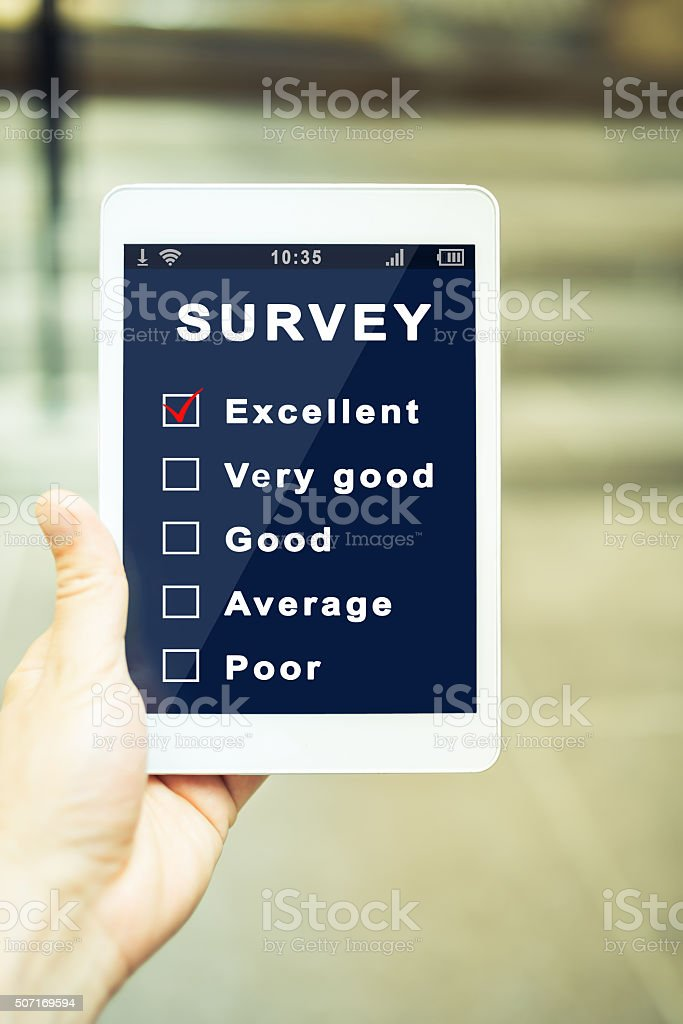 Online survey on a tablet stock photo