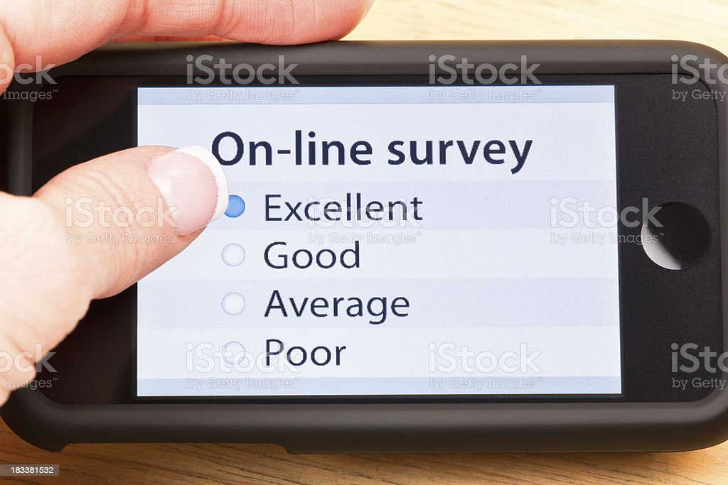 On-line survey with mobile phone royalty-free stock photo