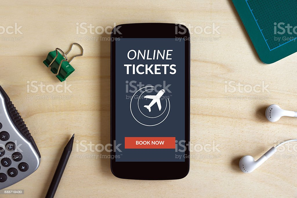 Online tickets concept on smart phone screen on wooden desk stock photo