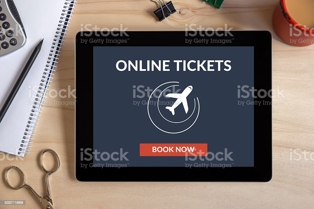 Online tickets concept on tablet screen with office objects stock photo