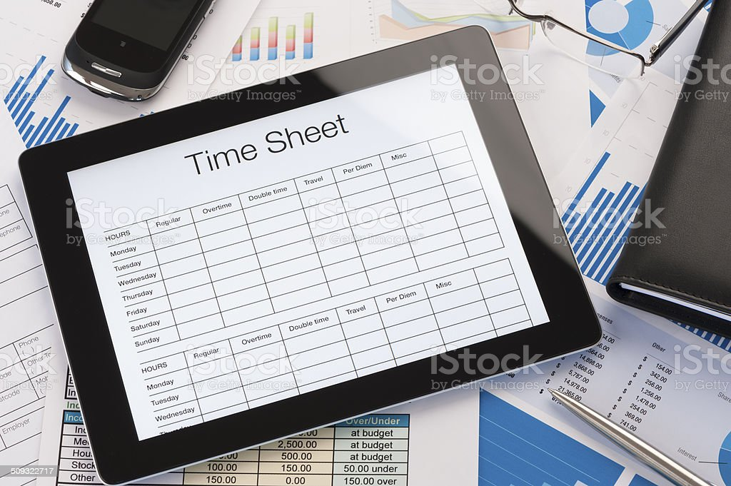 Online timesheet form on a digital tablet stock photo