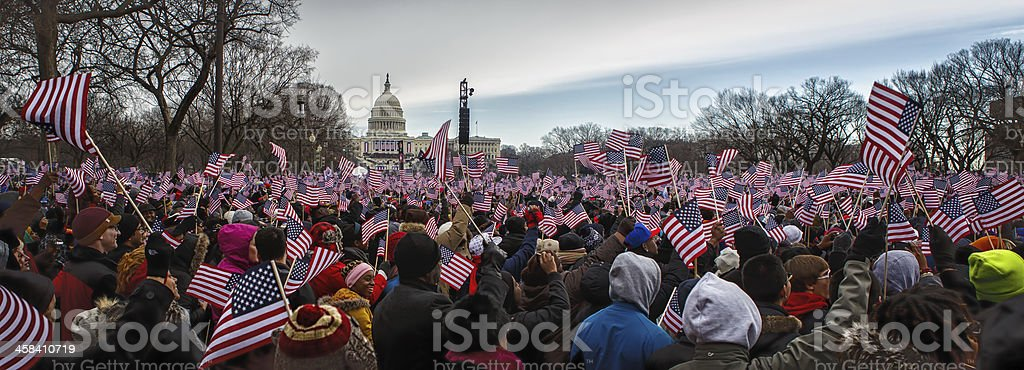 Onlookers observe 2013 Presidential Inauguration of Barack Obama stock photo