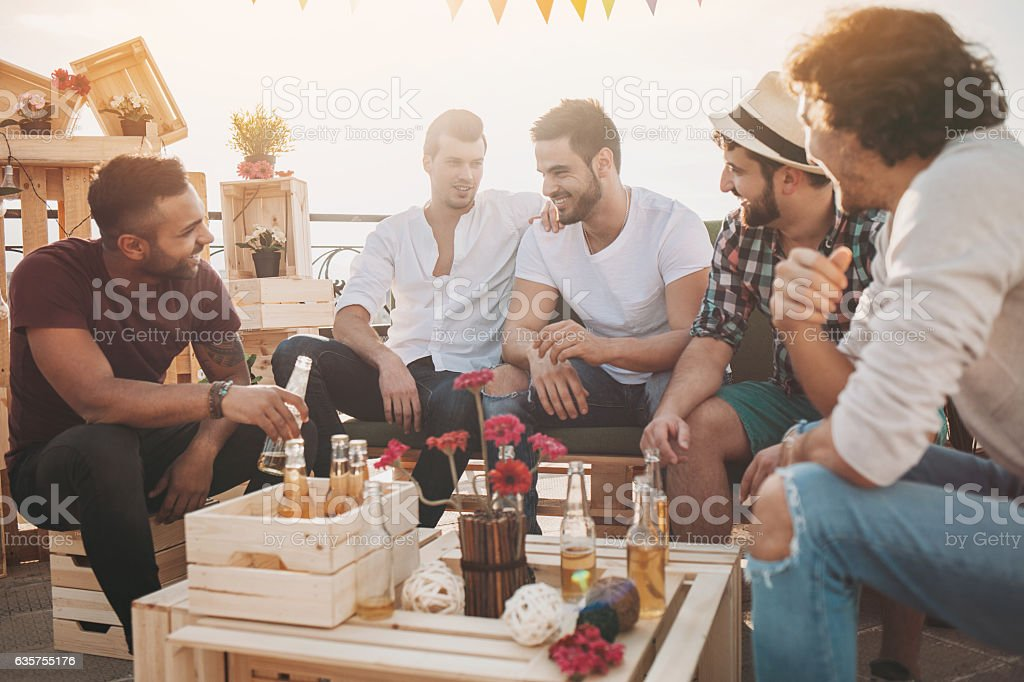 Only men on a party stock photo