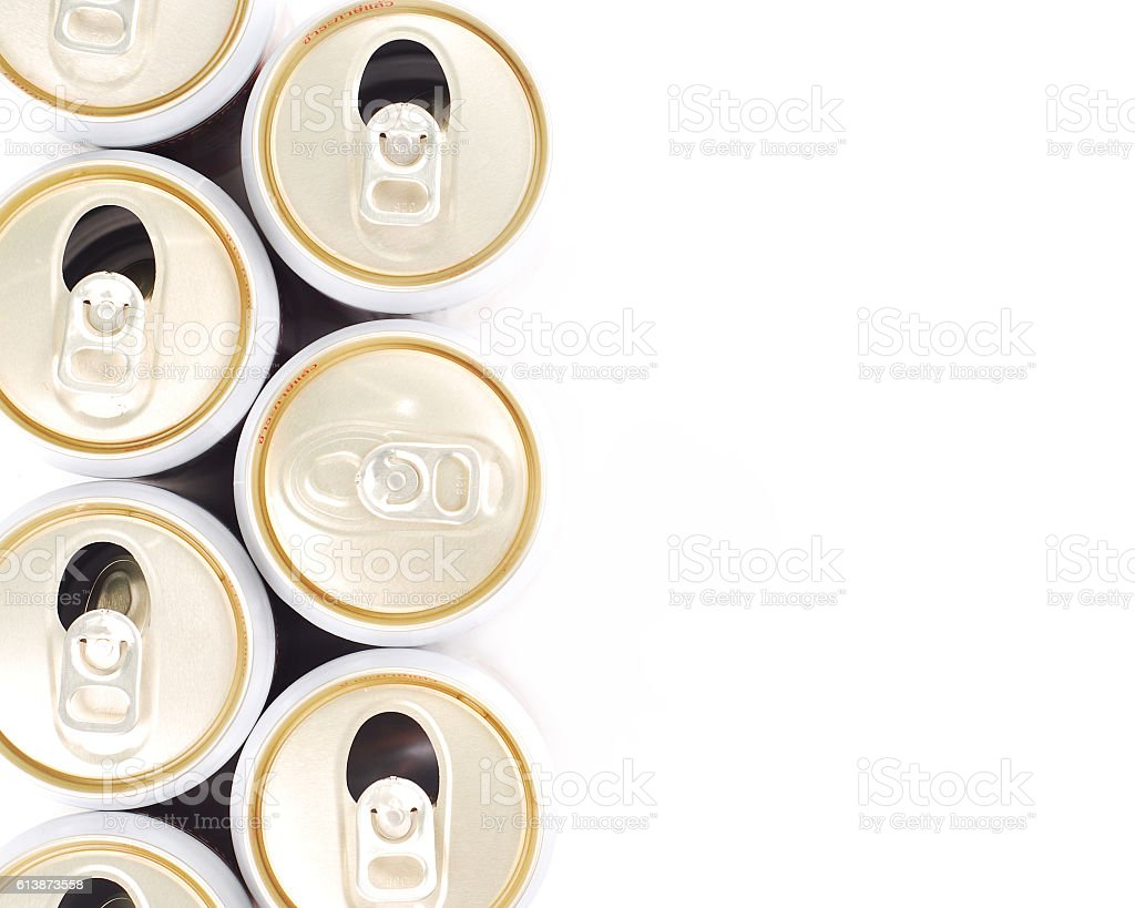 only un-opened drinks can in row of opened can stock photo
