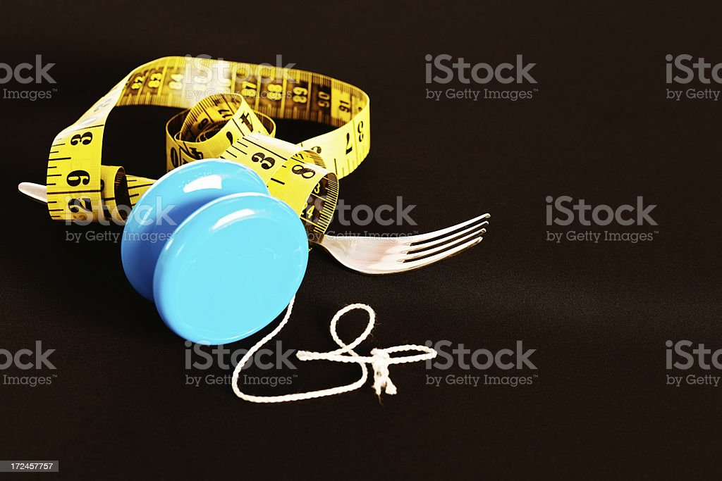 On-off dieting, varying measurements: that's the yo-yo syndrome! royalty-free stock photo