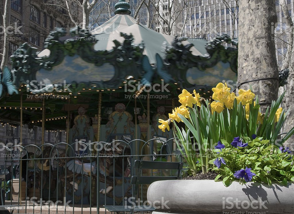 Onset of Spring - Flowers and Merry Go Round royalty-free stock photo