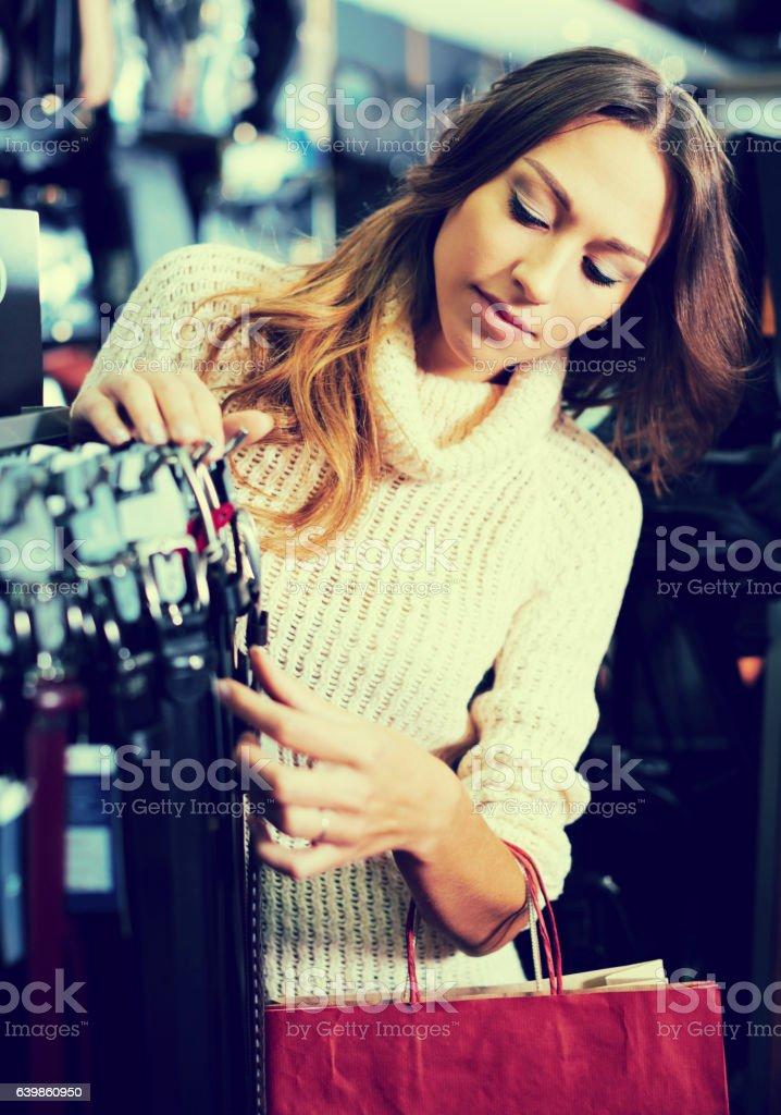 Ð¡onsumer choosing leather belts stock photo