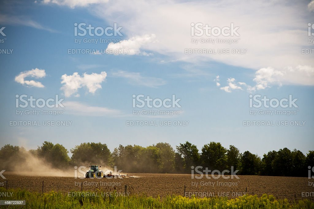 Ontario Farmer Plowing A Harvested Field stock photo