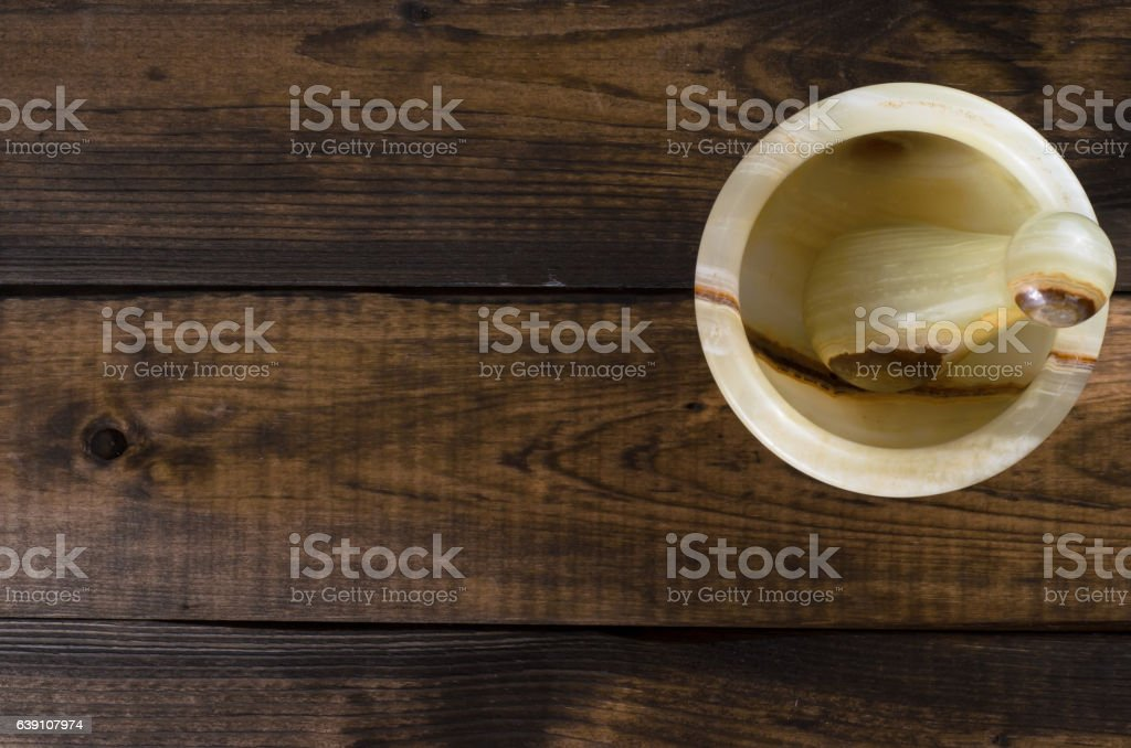 onyx Mortar and Pestle on wooden Background stock photo
