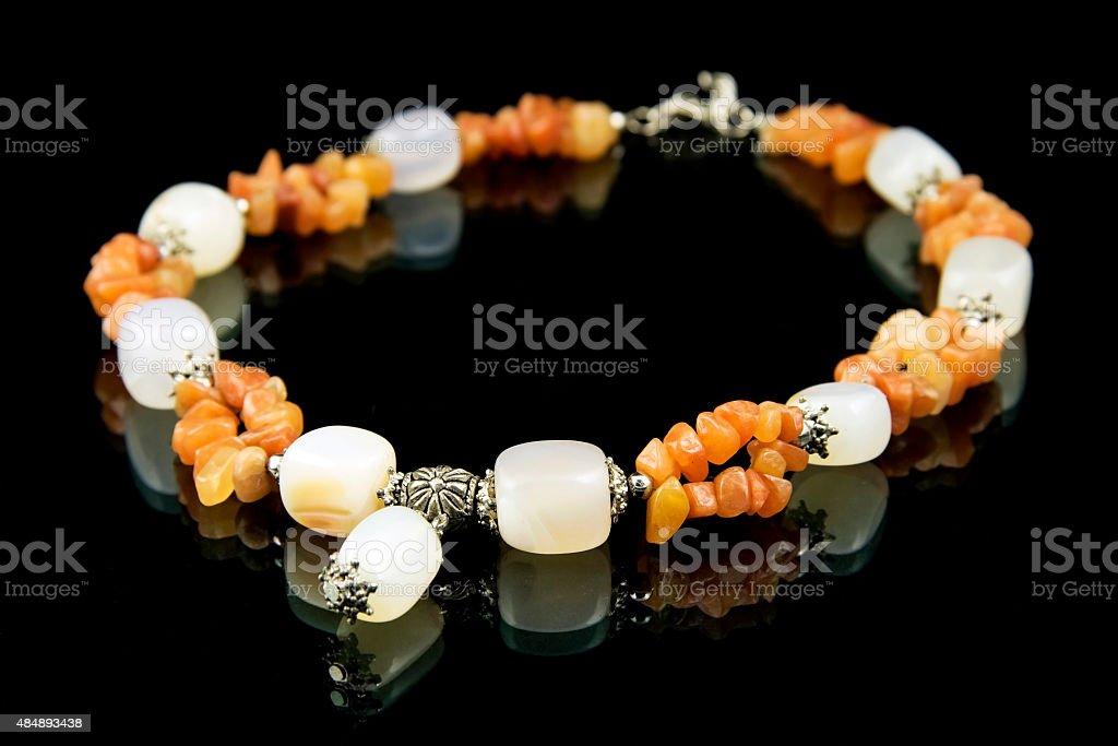 Onyx necklace isolated on  black  background stock photo