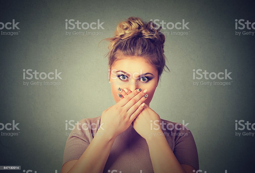 Oops! Surprised scared woman covering mouth with hands stock photo